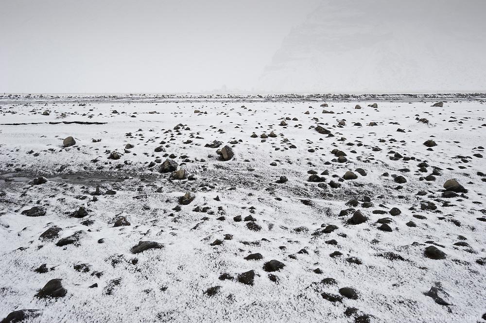 Near Þorvaldseyri farm in Eyjafjöll, Iceland. Fresh snow covers ground, laying on top of ash from Eyjafjallajökull Volcano.