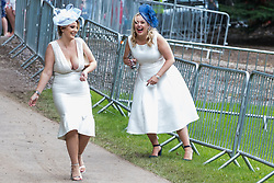 Ascot, UK. 20 June, 2019. Racegoers in high spirits as they leave Royal Ascot after attending Ladies Day.
