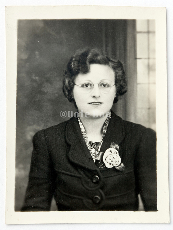 damaged vintage identity style head and shoulder portrait of a adult woman