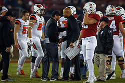 PALO ALTO, CA - NOVEMBER 10: Head coach David Shaw of the Stanford Cardinal shakes hands with head coach Jonathan Smith of the Oregon State Beavers after the game at Stanford Stadium on November 10, 2018 in Palo Alto, California. The Stanford Cardinal defeated the Oregon State Beavers 48-17. (Photo by Jason O. Watson/Getty Images) *** Local Caption *** David Shaw; Jonathan Smith