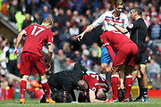 Liverpool midfielder Jordan Henderson (14) lies injured during the Premier League match between Liverpool and Stoke City at Anfield, Liverpool, England on 28 April 2018. Picture by Craig Galloway.