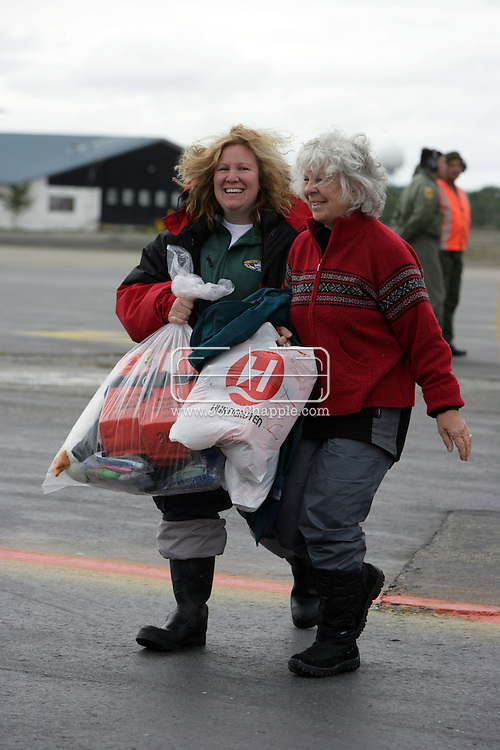 "25th November 2007, Punta Arenas, Chile. Survivors from the shipwrecked Antarctic vessel M/S Explorer arrive at Punta Arenas by military aircraft. 154 tourists and crew had spent the night on King George Island after their ship struck an iceberg and sank approximately 120km (75 miles) north of the Antarctic Peninsula. After several hours bobbing in small lifeboats surrounded by floating sheets of ice, they were plucked to safety by the Norwegian cruise ship, the Nordnorge. The ""Spirit of Shackleton"" 19-day cruise through the Drake Passage, cost from around $8,000 (£3,900) per cabin. Pictured the second group of passengers arriving at Punta Arenas airport..PHOTO © JOHN CHAPPLE / REBEL IMAGES.john@chapple.biz   www.chapple.biz"