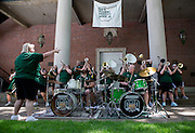 """Members of the Ohio Alumni Varsity Band perform for Ohio Univeristy alumni and their families during a barbecue on the College Green on May 31, 2014. The event was part of the """"On The Green"""" weekend, hosted by the Ohio University Alumni Association. Photo by Lauren Pond"""