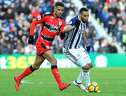 Steve Mounie of Huddersfield Town competes with Matt Phillips of West Bromwich Albion -Mandatory by-line: Nizaam Jones/JMP - 24/02/2018 - FOOTBALL - The Hawthorns - West Bromwich, England - West Bromwich Albion v Huddersfield Town- Premier League