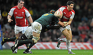 Photo © TOM DWYER / SECONDS LEFT IMAGES 2010 - Rugby Union - Invesco Perpetual Series - Wales v South Africa - 13/11/10 - Wales' James Hook tackled by Tendai Mtawarira and  Victor Matfield (scrum cap)- at Millennium Stadium Cardiff Wales UK -  All rights reserved