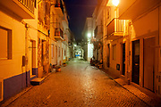 Night photography of a narrow alley in old town Nazare, Portugal