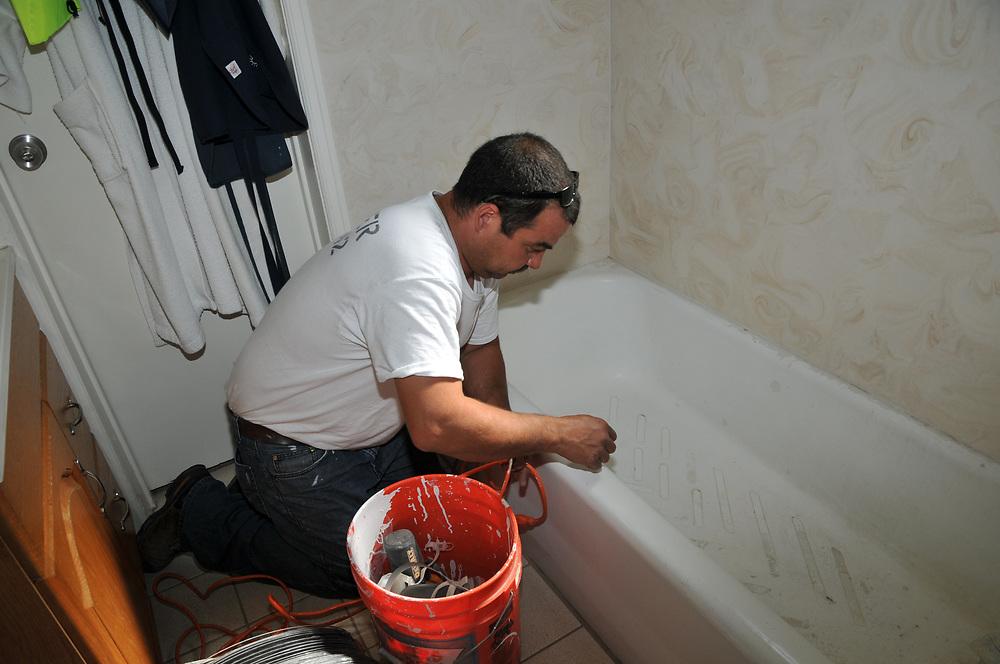Tub Tamers begin my bathtub refinishing process. First step is to sandblast the tub surface.