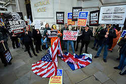 © Licensed to London News Pictures. 22/02/2020. LONDON, UK.  People in masks outside Australia House in Aldwych ahead of a march to Parliament Square in support of Wikileaks founder Julian Assange.  The full extradition trial of Mr Assange begins in London on 24 February.  Photo credit: Stephen Chung/LNP