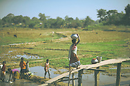 Woman carrying water, Khaziranga, Assam, India.