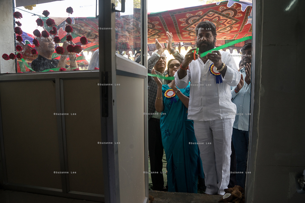 The head of the village cuts the ribbon during the launch of a Safe Water Network iJal station in village Marepally, Telangana, Indiia, on Wednesday, February 6, 2019. Photographer: Suzanne Lee for Safe Water Network