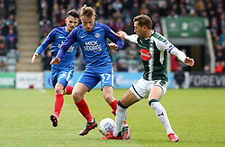George Cooper of Peterborough United in action with Gary Sawyer of Plymouth Argyle - Mandatory by-line: Joe Dent/JMP - 07/04/2018 - FOOTBALL - Home Park - Plymouth, England - Plymouth Argyle v Peterborough United - Sky Bet League One