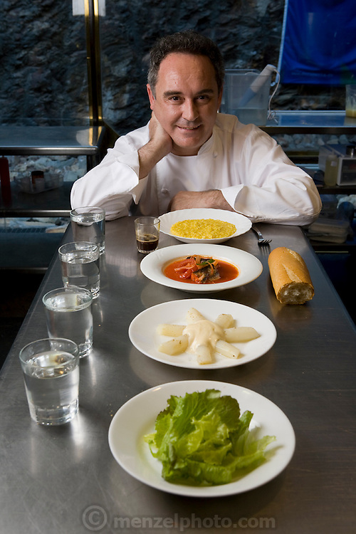 Ferran Adrià, chef of El Bulli restaurant near Rosas on the Costa Brava in Northern Spain on the Mediterranean, with the food he eats in one day (the lunch he has with the cook staff).  (Ferran Adrià is featured in the book What I Eat: Around the World in 80 Diets.) This food does not include any tasting throughout the day.  MODEL RELEASED. .