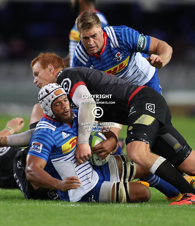 DURBAN, SOUTH AFRICA - MAY 27: Philip van der Walt (captain) of the Cell C Sharks tackling Nizaam Carr of the DHL Stormers during the Super Rugby match between Cell C Sharks and DHL Stormers at Growthpoint Kings Park on May 27, 2017 in Durban, South Africa. (Photo by Steve Haag/Gallo Images)