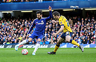 Cesc Fàbregas of Chelsea outwits Murray Wallace of Scunthorpe United during the The FA Cup match between Chelsea and Scunthorpe United at Stamford Bridge, London, England on 10 January 2016. Photo by Ken Sparks.