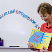 Jane Mortensen, kindergarten teacher at Betsy Ross Elementary in Forest Park, reads the ABCs to her class during the first week back to school, Friday, August 26, 2011. Photo by J.Geil
