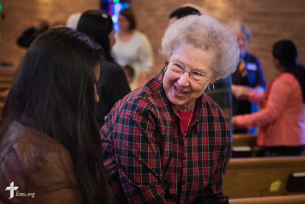 Church members greet each other during a monthly bilingual worship on Sunday, Nov. 22, 2015, at Salem Lutheran Church in Springdale, Ark. LCMS Communications/Erik M. Lunsford