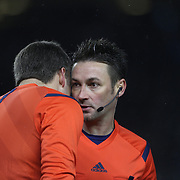 Referee Edvin Jurisevic, (right), consults his assiatant referee after awarding a penalty to NYCFC, he overturned his ruling after consultation during the New York City FC Vs Sporting Kansas City, MSL regular season football match at Yankee Stadium, The Bronx, New York,  USA. 27th March 2015. Photo Tim Clayton