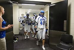 28 May 2007: Duke Blue Devils defenseman Casey Carroll (37), attackman Matt Danowski (40) and teammates exit the locker room before playing Johns Hopkins in the NCAA Championship at M&T Stadium in Baltimore, MD.