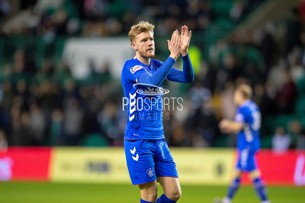 Joe Worrall (#3) of Rangers FC capplauds the Rangers fans during the Ladbrokes Scottish Premiership match between Hibernian and Rangers at Easter Road, Edinburgh, Scotland on 8 March 2019.
