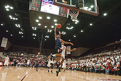 November 18, 2010; Stanford, CA, USA;  Virginia Cavaliers guard Mustapha Farrakhan (2) shoots past Stanford Cardinal guard/forward Anthony Brown (3) during the second half at Maples Pavilion.  Stanford defeated Virginia 81-60.