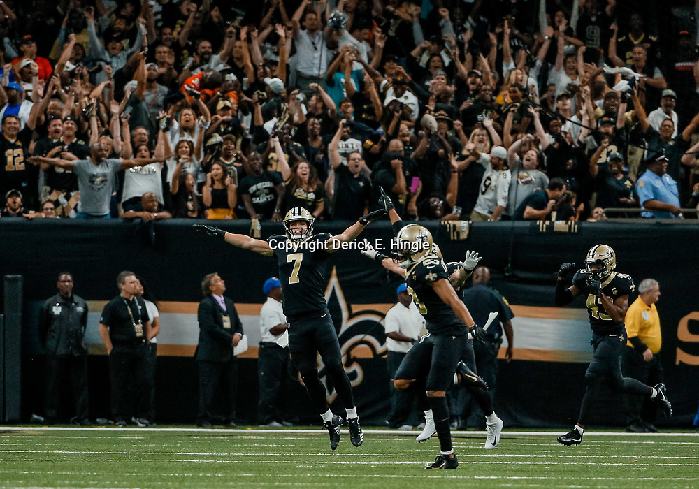 Sep 16, 2018; New Orleans, LA, USA; New Orleans Saints specialist Taysom Hill (7) and teammates celebrate following a missed extra point attempt by Cleveland Browns place kicker Zane Gonzalez (2) during the fourth quarter of a game at the Mercedes-Benz Superdome. The Saints defeated the Browns 21-18. Mandatory Credit: Derick E. Hingle-USA TODAY Sports