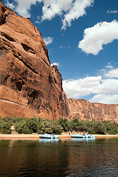 Glen Canyon, Arizona: Rest stop on a float trip down 15 miles of the Colorado River running south through Glen Canyon, below the Glen Canyon Dam.  Trip guided by Wilderness River Adventures (managed by ARAMARK), the only operator (2006) permitted between the dam and Lees Ferry (take-out).  Additional views, both horizontal and vertical, with different horizon placements available.