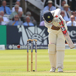 India's Cheteshwar Pujara playing safe during the first day of the Investec 2nd Test match between England and India at Lords, London, 17th July 2014 © Phil Duncan | SportPix.org.uk