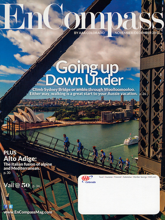 Cover photo of EnCompass Magazine showing the Sydney Harbour Bridge Climb in Sydney, Australia with the Sydney Opera House in background by Blaine Harrington III.