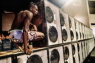 "Roadie assembling a soudsystem for the ""Rio Parada Funk"" (Rio Funk Parade 2014) inside the Sambodromo."