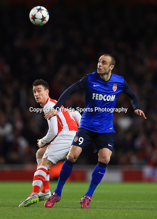 25 February 2015 - UEFA Champions League - Last 16 (1st Leg) - Arsenal v AS Monaco - Dimitar Berbatov of AS Monaco in action with Laurent Koscielny of Arsenal - Photo: Marc Atkins / Offside.