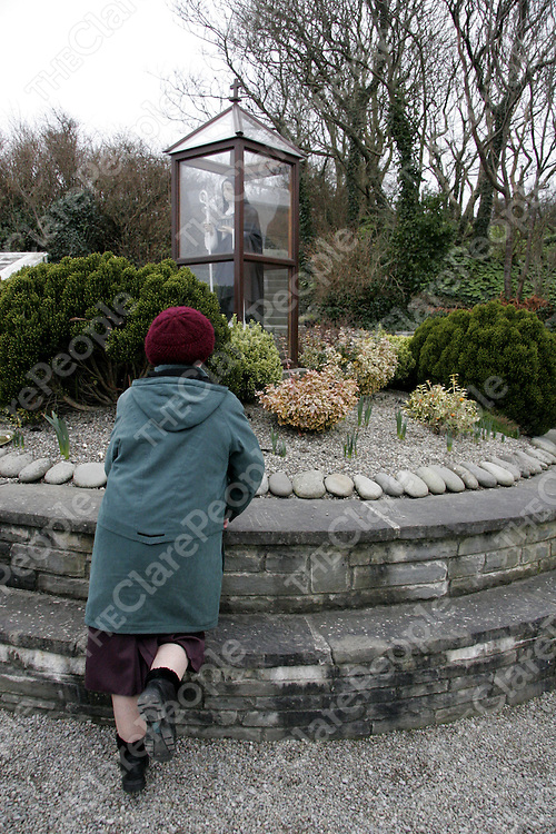 A local woman begins her 'prayer round' at St. Bridget's Well in Liscannor during the week.<br />