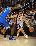 Feb. 4, 2011; Phoenix, AZ, USA; Phoenix Suns guard Steve Nash (13) drives the ball against Oklahoma City Thunder forward Serge Ibaka (9) at the US Airways Center. The Thunder defeated the Suns 111-107. Mandatory Credit: Jennifer Stewart-US PRESSWIRE