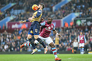 Arsenal's Olivier Giroud controls the ball with his chest during the Barclays Premier League match between Aston Villa and Arsenal at Villa Park, Birmingham, England on 13 December 2015. Photo by Shane Healey.
