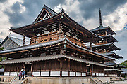 Kondo (Main Hall). 5-story pagoda, world's oldest wooden building. Horyuji Temple, Nara Prefecture, Japan. Horyu-ji Temple was founded in 607 by Prince Shotoku, an early promoter of Buddhism in Japan. In the foreground is the Kondo (Main Hall), rebuilt in 1954 after a 1949 fire destroyed 80-85% of its wood. Horyuji Temple's five-story pagoda (32 meters or 122 feet high, seen in background) is the oldest wooden building existing in the world. The wood used in the center pillar of the pagoda is estimated through a dendrochronological analysis to have been felled in 594. Horyuji Temple was founded in 607 by Prince Shotoku, an early promoter of Buddhism in Japan. Horyuji is one of the country's oldest temples and contains the world's oldest surviving wooden structures. It was designated a UNESCO World Heritage Site in 1993.