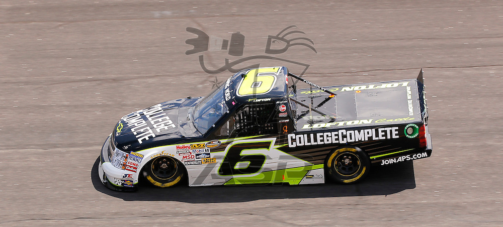 ROCKINGHAM, NC - APR 13, 2012:  Justin Loftin brings his truck through the turns during the a practice session for the Inaugural Good Sam Roadside Assistance 200 Camping World Truck Series race at the Rockingham Speedway in Rockingham, NC.