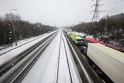© Licensed to London News Pictures. 01/03/2018. Huddersfield UK. Traffic is at a standstill westbound on the M62 while the Eastbound carriageway has been blocked by snow near Huddersfield as the Beast from the East continues to batter the UK. Photo credit: Andrew McCaren/LNP