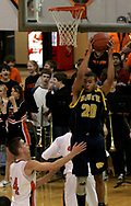 The Wildcats Vince Martin (20) comes down with a rebound as the Beavercreek Beavers host the Springfield South High School Wildcats Friday night, February 2, 2007.