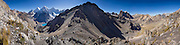 Cordillera Huayhuash panorama from San Antonio Pass (5000 meters or 16,4000 feet) includes: snowy Yerupaja Grande (6635 m or 21,770 ft, highest peak in the Amazon basin); Siula Grande (6344 m or 20,800 ft) which only appears higher from this perspective; turquoise lake Juraucocha 4343 m; and Cuyoc Valley on right. Day 6 of 9 days trekking around the Cordillera Huayhuash in the Andes Mountains, Peru, South America. This panorama was stitched from 12 overlapping photos.