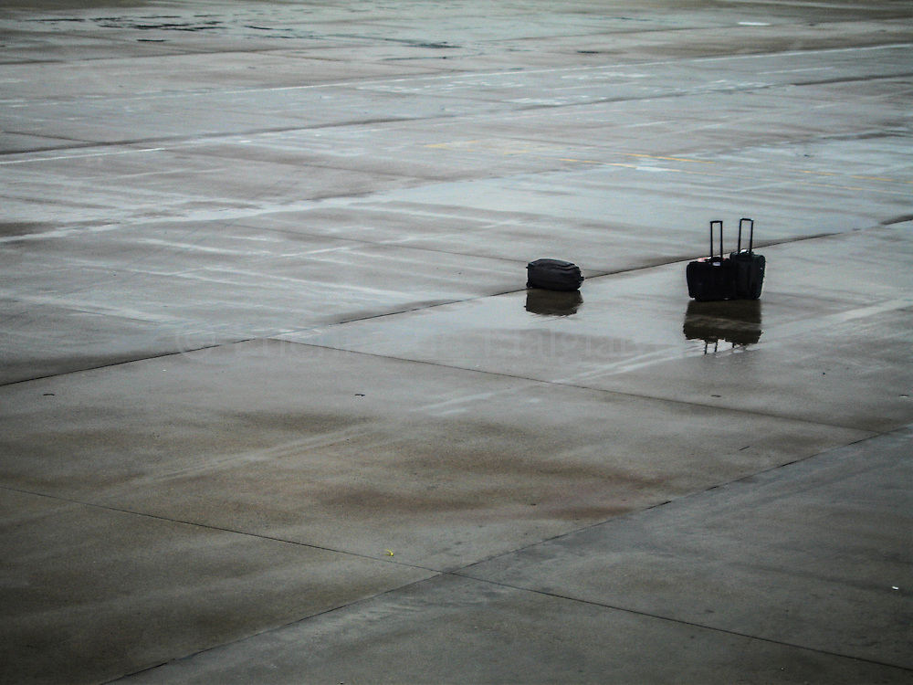 Luggages left on the tarmac of Colorado Springs airport.   October 2006.