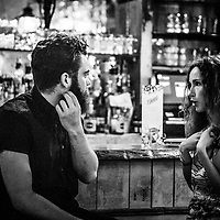 Couple talking sitting at bar