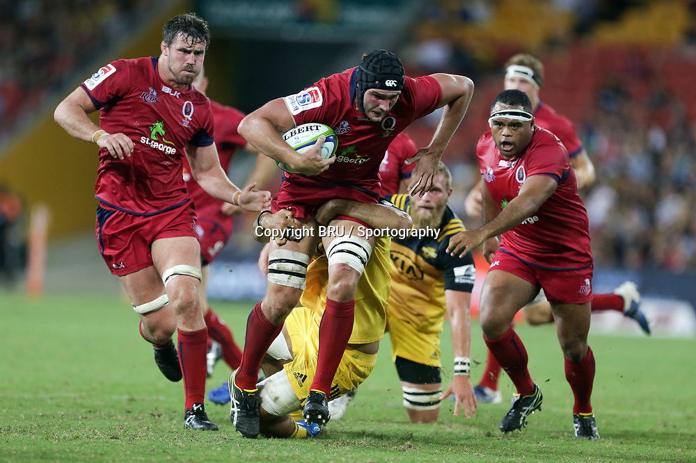Rob Simmons of the Reds tries to break a tackle. Reds v Hurricanes, round 6 of the Investec Super Rugby Championship at Suncorp Stadium, Brisbane, Australia. 1 April 2017.<br /> Copyright photo: Chris Cutler / Sportography / BRU