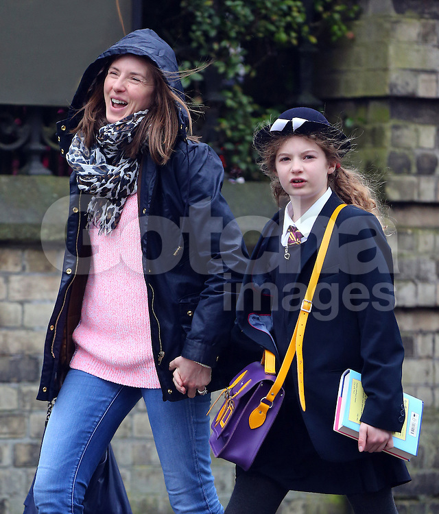 Celebrity Chef Jamie Oliver's wife Jools Oliver out with their eldest daughter Poppy Honey Rosie Oliver in north London, UK. 07/03/2013<br />