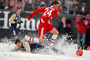 Tim Borowski battles in the snow during the game between FC Eintracht Bamberg v FC Bayern München in Weismain, Germany, Bundelsiga, 17th Jan 09.