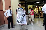 """Roma 26 Giugno 2009.Manifestazione di un gruppo di  «Antirazzisti e antirazziste» , davanti al supermercato Auchan di via Pollio a Casal Bertone, che protestano contro la vendita di prodotti e delle aziende che investono in Israele e per questo chiedono il boicottaggio delle merci..Rome 26 June 2009  .Demonstration of a group of 'anti-racism and anti-racist', in front of the Auchan supermarket, protesting against the sale of products and companies that invest in Israel and for this ask the boycotting of the commodities. The banner reads :""""Reject the Apartheid, boycotting Israel"""""""