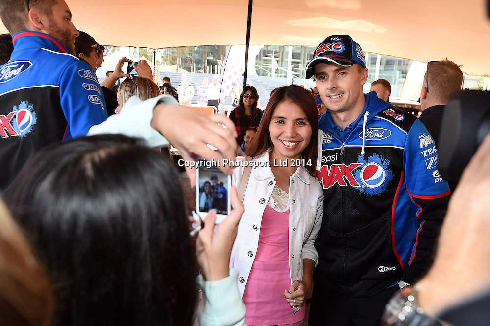 Mark Winterbottom poses for a photo, V8 Supercar drivers participate in a pit stop competition and fan signing session in Aotea Square, Queen St, Auckland ahead of this weekends ITM 500. 23 April 2014. Photo: Andrew Cornaga/www.photosport.co.nz
