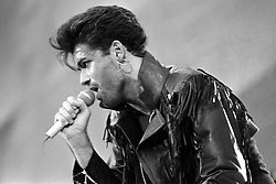 George Michael singing at Wembley Stadium for the Wham! sell-out farewell concert.