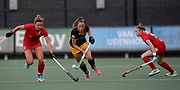 Den Bosch's Pien Sanders gets away from  Monkstown's Nicola Evans (L) and Laura Pinder during their opening game of the EHCC 2017 at Den Bosch HC, The Netherlands, 2nd June 2017