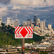 Road End sign and view of Seattle, Washington skyline at sunset from the east hill of the Magnolia neighborhood