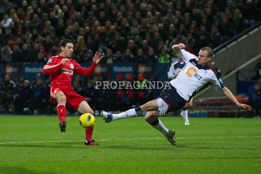 BOLTON, ENGLAND - Saturday, January 21, 2011: Liverpool's Maximiliano Ruben Maxi Rodriguez in action against Bolton Wanderers' David Wheater during the Premiership match at the Reebok Stadium. (Pic by David Rawcliffe/Propaganda)