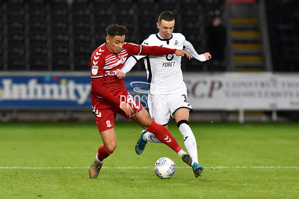 Marcus Tavernier (7) of Middlesbrough battles for possession with Bersant Celina (10) of Swansea City during the EFL Sky Bet Championship match between Swansea City and Middlesbrough at the Liberty Stadium, Swansea, Wales on 14 December 2019.